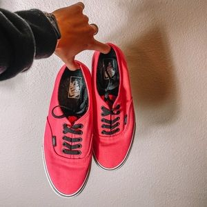 Hot pink Vans sneakers with black laces
